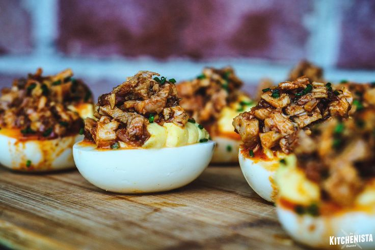 Tangy overstuffed deviled eggs topped with bbq chicken or pulled pork, for the perfect cookout appetizer!