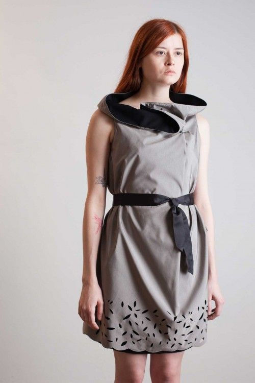 Holes winter dress - Variable and minimal geometries for this deconstructed dress in a laser cut gray fabric with floral pattern.