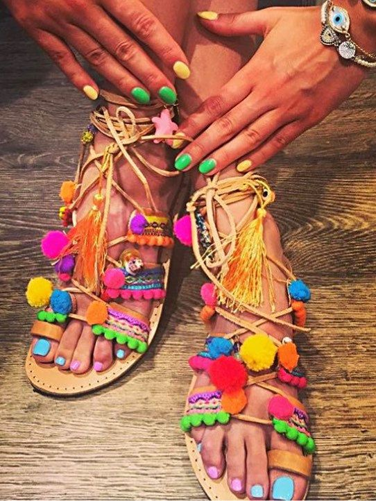 Leather boho pompom gladiator sandals. Multicoloured strappy sandals decorated with semi-precious stones, cotton multicolour straps, pompoms in neon pink, yellow, blue and purple colours. Bright and fun for festival or beach!