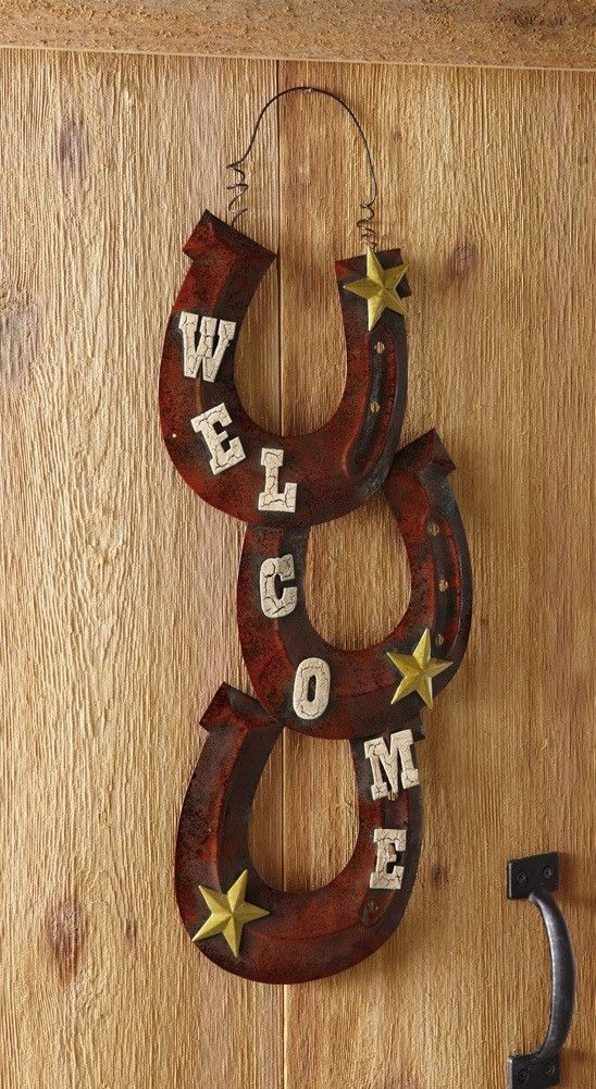 "Horseshoe Welcome Greet guests with this arrangement of horse shoes on your door. This charming western accent is crafted of iron with a rustic finish and decorated with golden stars. 9 1/2""W x 22 3/4""H. Please allow 7-15 days for item to arrive once payment is made. Local pickup is welcome for this item. Please check my other great items. All items come from pet-free smoke-free environment. Please email me for any questions. Return Policy: Returns are accepted within 14 days of receipt of…"