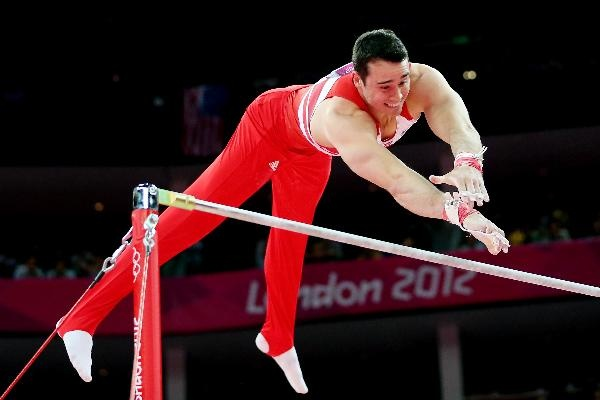 Kristian Thomas of Great Britain competes on the horizontal bar in the Artistic Gymnastics Men's Team final on Day 3 of the London 2012 Olympic Games at North Greenwich Arena on July 30, 2012 in London, England.