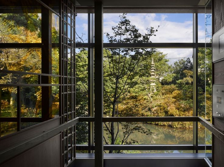 Glass lift facing the garden at the four seasons kyoto by hba design