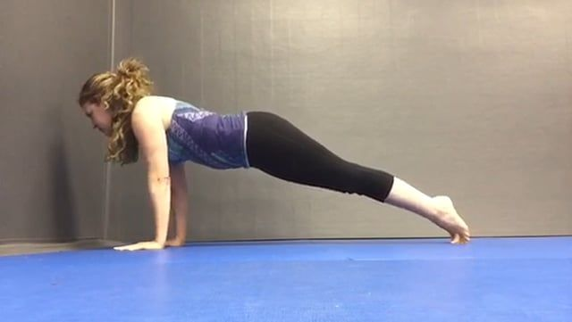 A tutorial for Chaturanga. Notice the distance for proper arms and feet placement. You can do this if you start in Plank pose, raise hips to Down Dog for the proper alignment. Come forward to Plank again and slowly lower the body down without arching your back or dropping your hips down. Pull the body forward going up on your toes so your feet are basically vertical. Hover horizontally for a full breath count (inhale & exhale) before lowering your body down and rolling over your toes so to…
