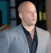 Actor Vin Diesel stars as Dominic Toretto in the Fast and Furious franchise as an elite street racer, professional criminal, street racer, ex-convict, and fugitive. His crew includes Jesse, Leon, Vince, and Letty Ortiz. Fast and the Furious (2001), The Fast and the Furious:Tokyo Drift (2006), Fast and Furious (2009), Fast Five (2011), Diesel was reportedly paid $15 million to star in and produce the film. He also starred in Fast & Furious 6 (2013), and Furious 7 (2015).