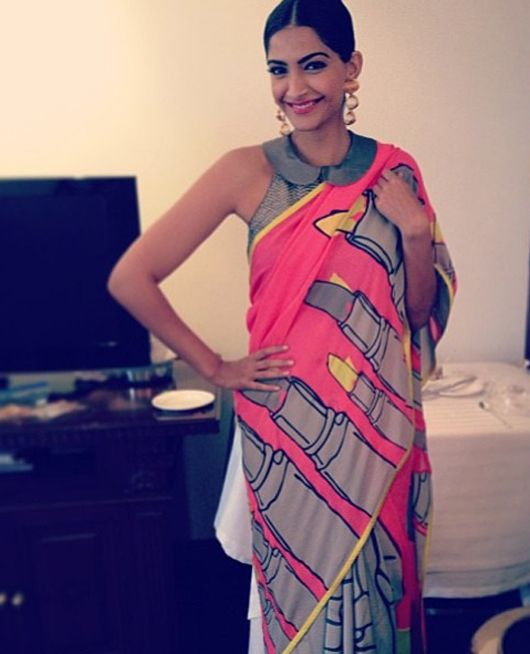 Sonam in Masaba Gupta for Satya Paul....love the lipstick print saree+pererpan collar blouse!!