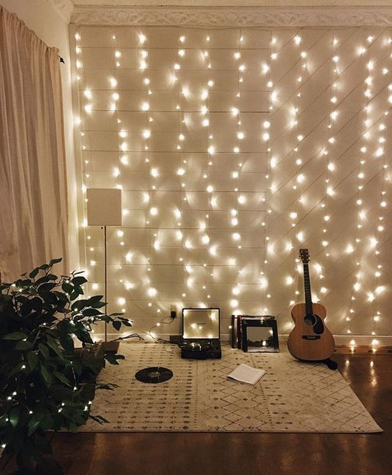 20 A Hobby Nook In The Living Room Is Accented With Whole String Lights Wall