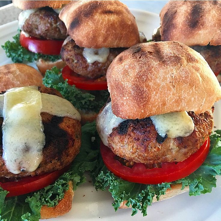 This was fun... Turkey sliders made with roasted garlic, roasted Serrano peppers and lots of fresh cilantro. Grilled over apple wood chips, topped with Gruyère cheese and served on toasted ciabatta buns with fresh kale and tomatoes.@zimmysnook