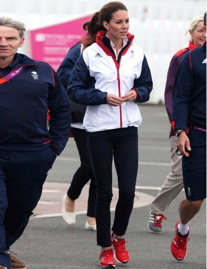 Kate Middleton wearing the official Adidas white team GB jacket watches the Olympic sailing in Weymouth, August 2012.
