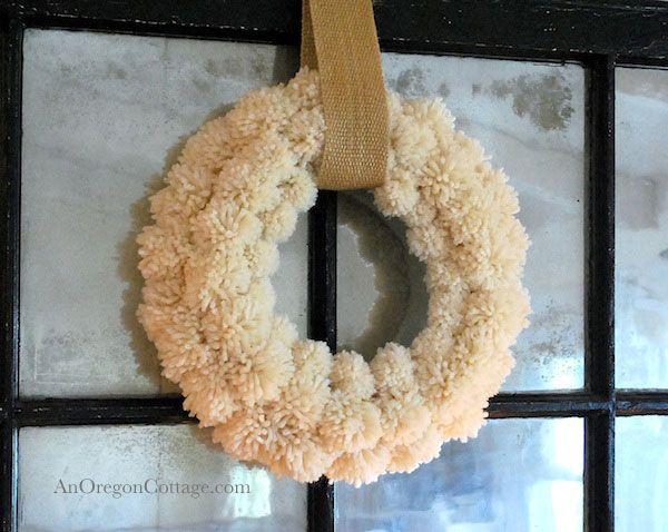 DIY Wool Pom-Pom Wreath - i love this wreath. it looks like a warm, cozy sweater for my wall.  :)