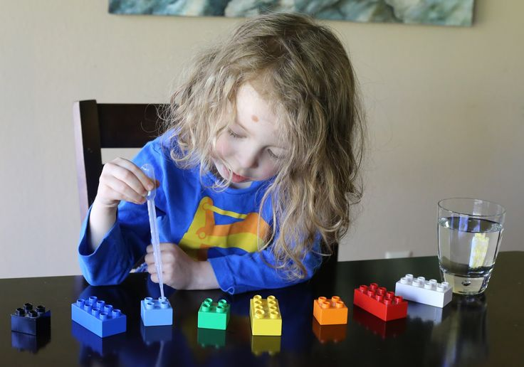 Using water and an eyedropper, fill in the tiny holes of LEGO bricks. There are fun nooks and crannies on the back sides of each brick:) #finemotorskills