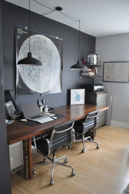 dark stylish home office. Love the space for two computers and chairs!