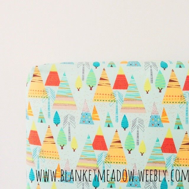 The perfect fitted cot sheet for a modern cowboys and Indians themed nursery. I love teepees!