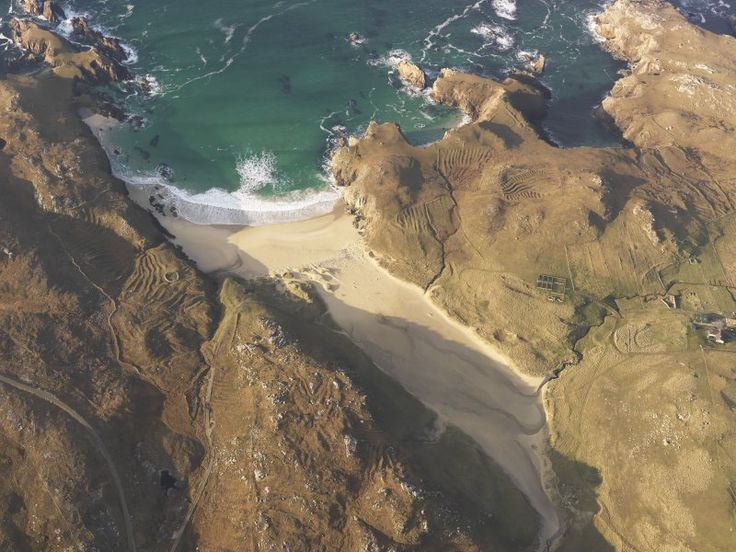 Love this aerial photograph of Mangersta Beach on the west coast of the Isle of Lewis, Scotland. The old lazy bed - Feannagan taomaidh in Gaelic - field systems around the beach stand out clearly when you see them from the air.  These cultivation ridges were dug with a spade and were often used for growing potatoes. There are several other archaeological sites within this photo including prehistoric promontory enclosures, on the cliff-tops either side of the beach.