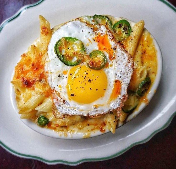 Maison Pickle  2315 Broadway  This new American and comfort food restaurant, opened by the owners of Jacob's Pickles (next on our list) has a classique and midnight style mac and cheese on their menu.  The Midnight is made with sausage, jalapeño, cheese, and topped with a fried egg!