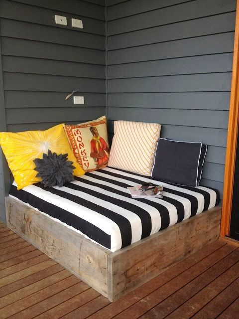 Simple and Easy porch bed. A corner inside would work too. This would be a fun reading spot for kids.
