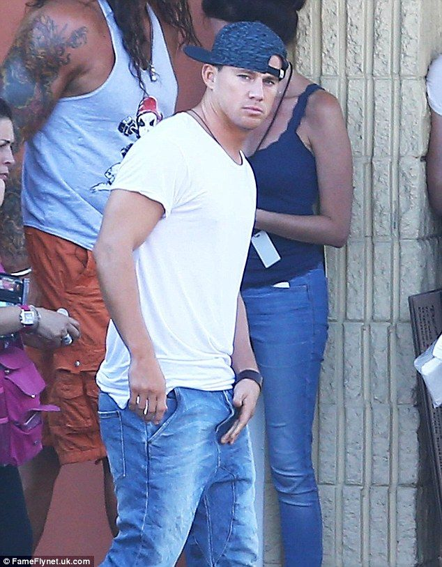 Playing it cool: Channing Tatum strutted his hunky physique around the Savannah, Georgia set of Magic Mike XXL on Wednesday in jeans, white T-shirt and reverse cap