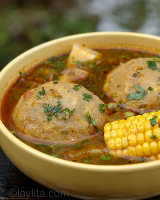 Caldo de bolas de verde is a typical Ecuadorian soup of green plantain balls or dumplings stuffed with meat and served in a delicious broth with corn and yuca.
