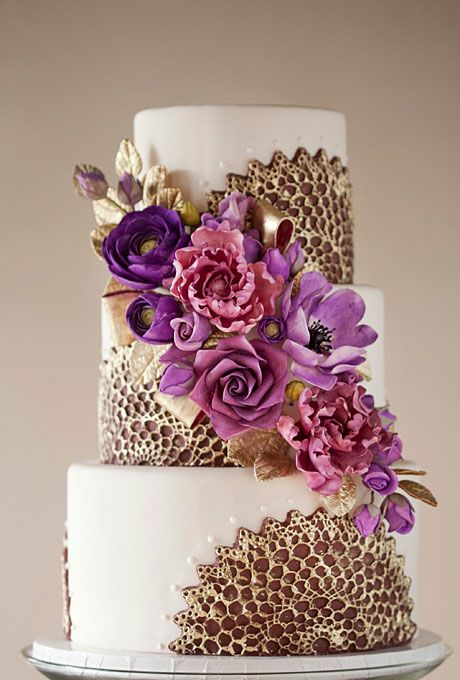 Purple and Gold Wedding Cake,Wild Orchid Baking Company. Combine flowers and colors to match your theme, wristbands for brides maids, wine charms for gifts to brides' maids. Make that fan a sea shell for beach theme! Infused by PJ, Certified Wedding Expert. Where will your wedding be? Start here for venues: http://destinationweddings.travel/default.asp?sid=23734&pid=35479 #allweddingsallowed #allcouplesallowed