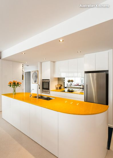 a built-in mirror that doubles as a splashback behind the hob almost creates a window in this modern kitchen. If you're designing from scratch, and it's feasible, aim to have a mirrored splashback opposite a window to boost light and also to reflect some greenery or rooftops and sky into the kitchen. | houzz