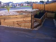 Timber Retaining Wall with Steps Warragul. Landscaper Pakenham - Ground Up Garden Renovators www.gardenrenovators.com.au