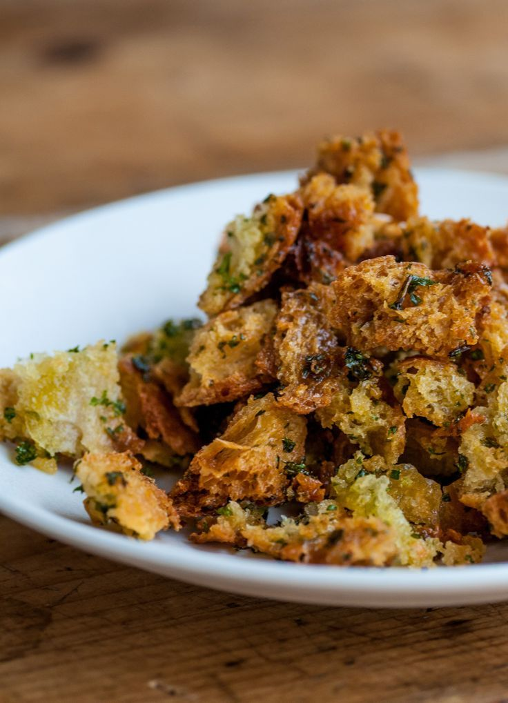 Garlic bread croutons - Dominic Chapman. Simply scattered over pasta dishes, seasonal soups or folded through salad, this garlic croutons recipe should be kept in your repertoire to liven up everyday dishes.