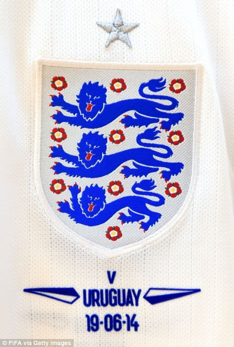 Emblem detail of the shirt worn by England hangs in the dressing room at Arena de Sao Paul...