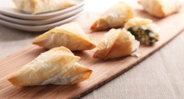 Try spraying the filo pastry with a little olive oil before you begin folding into triangles. This will make the pastry turn crisp and golden in the oven.
