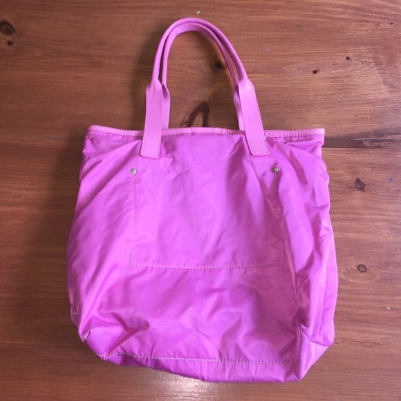 "J Crew Neon Pink Tote Bag Neon pink tote bag. Lined inside with two pockets. Magnetic snap closure. Outside of tote bag is nylon-like material, easy to clean. Leather-look handles. Approx dimensions 13"" length x 14.5"" wide. Only used a few times, in good condition. J. Crew Bags Totes"