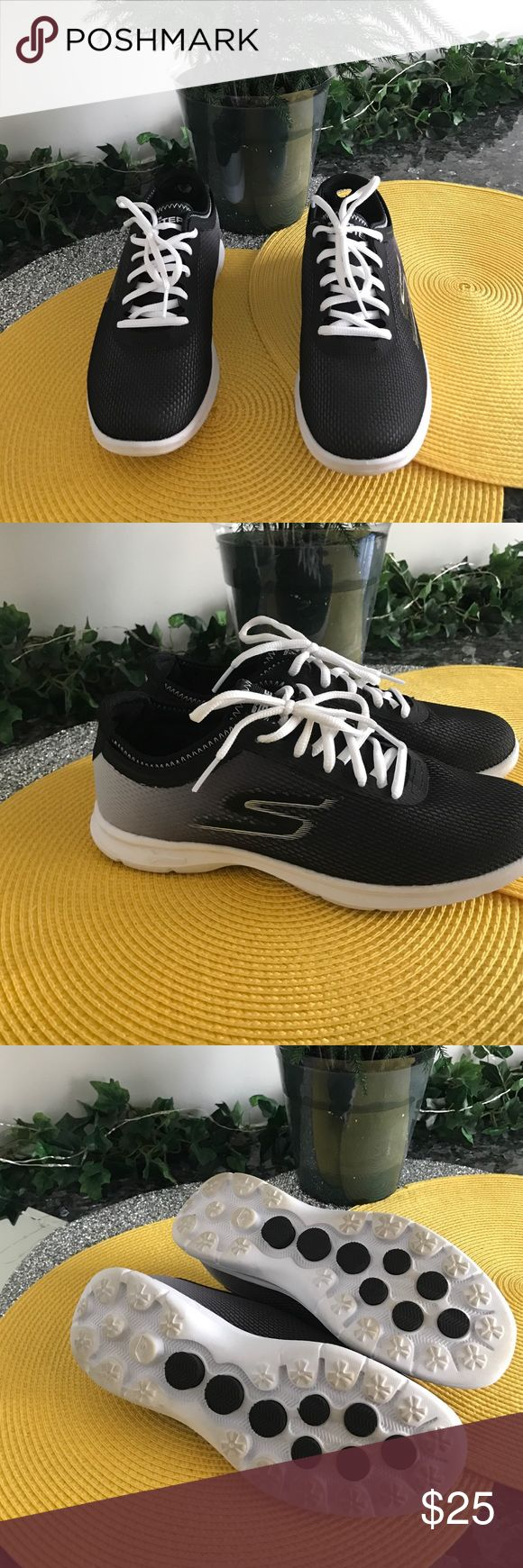 Skechers black shoes  with white trim Black Skechers shoes with white trim extra black laces.  Very comfortable.  In good condition. Worn about 3 times Skechers Shoes