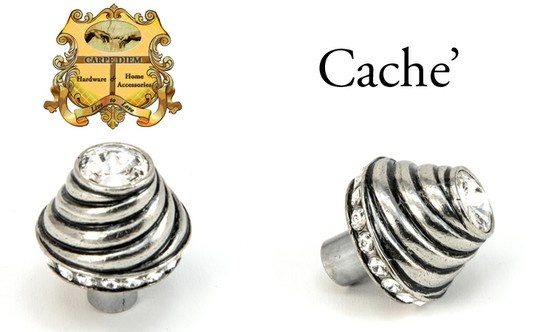 "Carpe Diem Hardware style# 864 Caché large round knob with Swarovski Elements. This stands up and demands attention in the room. No shyness here. A total of 18 - 5.25mm ""Rivioli"" stones surround the base of the knob, with a wave rising to the top of the knob presenting a large 16mm ""Rivioli"" crystal. Part Carpe Diem's 360 degree of design this knob does not disappoint when looking to create a bold statement. Shown in Chalice finish with Clear crystals"