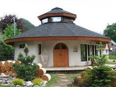 Octagonal straw bale house--guest house. Guttering to rain-water collection to run sinks, gray-water sumps, composting toilet, passive solar, low energy lights and wood heat.  Need to find a low energy way to cook...