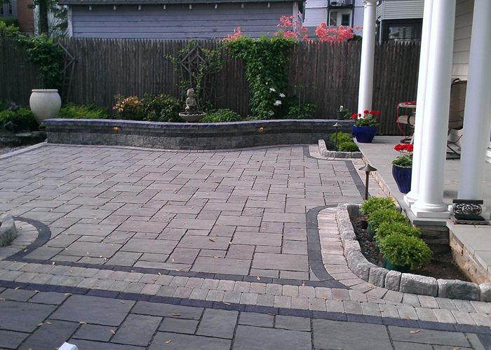 Permeable Paver Patio With A Strong Black Accent Band And Border By Bahler  Brothers In West