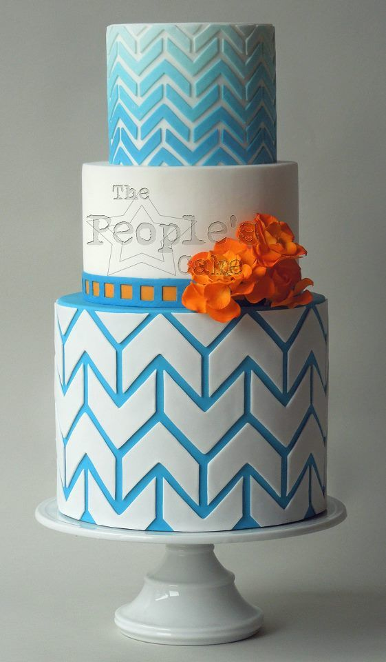 Bold ombre chevron wedding cake and a pop of orange garden roses
