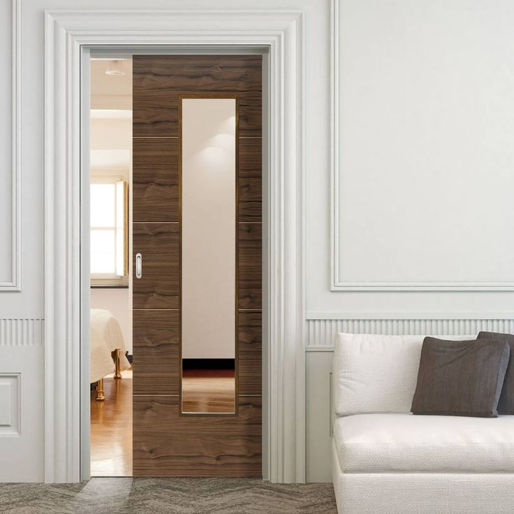 Single Pocket Parisienne Walnut decorative grooves sliding door system in three size widths with clear glass. #walnutdoor #internalglazeddoor #wlanutpocketslidingdoor