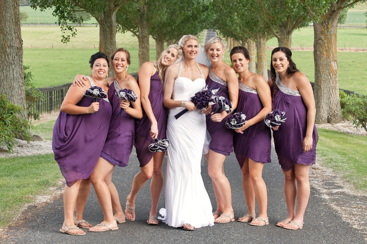 Casey & her bridesmaids with their flaxation wedding bouquets. The bridesmaids have our large bridesmaid posy in purple & silver.  www.flaxation.co.nz