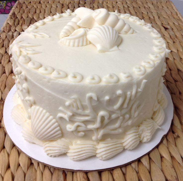 Classic vanilla cake with white chocolate sea shells.