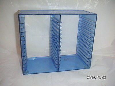 plastic cd desk shelf rack holds 30 cd jewel cases in a cool blue translucent color