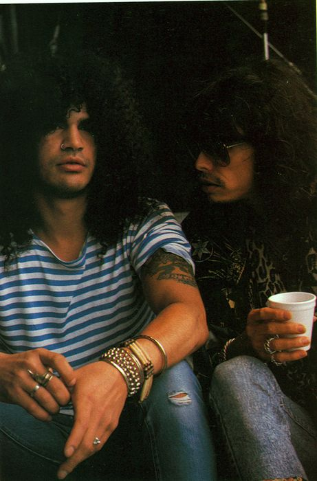 """My thoughts when I see this pic of Slash and Steven Tyler: After partying all night after a concert the night before and going to next venue- Steven to Slash : """"What city are we in?"""""""