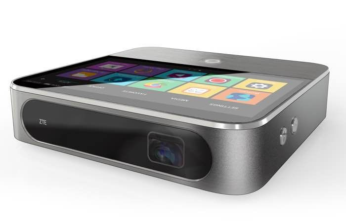 ZTE Spro 2 Is a Mini Projector and Hotspot In One - The device is capable of projection HD video at a resolution of 1280 x 720 pixels up to a screen size of 120 inches, it comes with a brightness of 200 lumens, and features a 6300 mAh battery. The ZTE Spro 2 measures 5.1 inches by 5.2 inches by 1.5 inches thick, and it comes with 4G LTE and can be used as a mobile hotspot for up to eight devices. | Geeky Gadgets