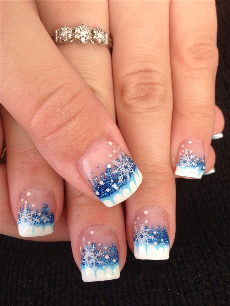 Winter gel nails with blue glitter and snowflake nail art design