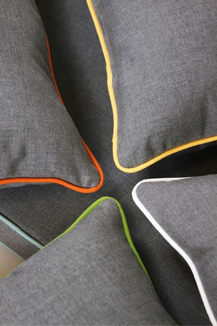 Love this fun idea to add bright, colorful piping to #Sunbrella Cast Slate throw pillows!