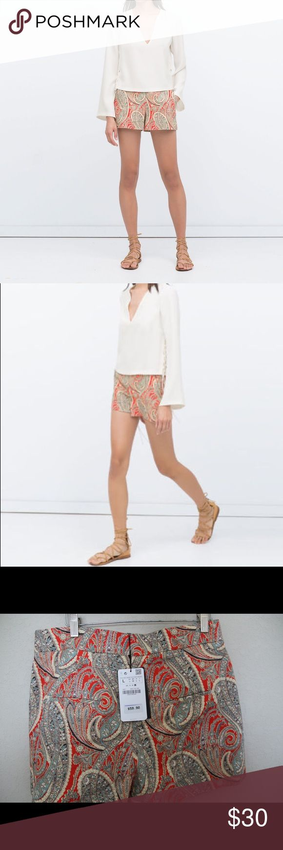 Zara red orange paisley shorts size M AMAZING ZARA MULTICOLOR PAISLEY PRINT SHORTS - Red and Orange tones  Be your own stylist with this fabulous piece.  A long tee, a dressy blouse, a chambray tied shirt all work with this versatile top.  Pack it on vacation and you have many looks.  Dress it up with heels or a wedge and dress it down with flip-flops, sneakers, or a gladiator sandal.  EVERYTHING WORKS! You will love wearing it and the compliments will be plentiful.....  SIZE M  98% COTTON…
