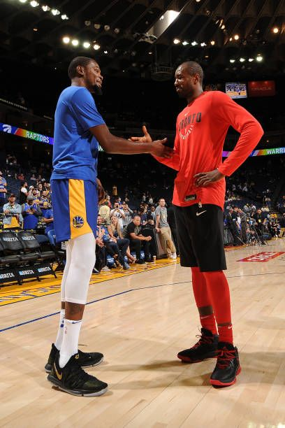 Kevin Durant of the Golden State Warriors and Serge Ibaka of the Toronto Raptors talk before the game on October 25 2017 at ORACLE Arena in Oakland...