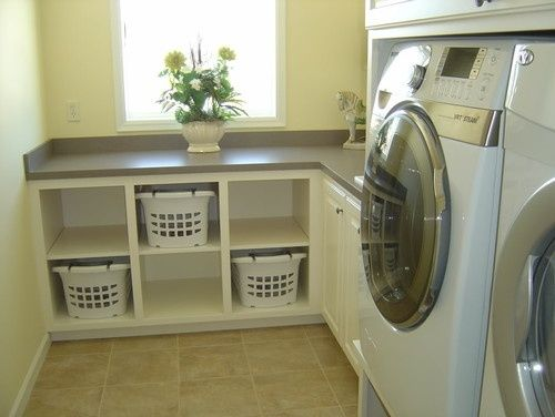 Folding counter with space for everyone's basket of clean clothes below. Place an ironing cover on the top to save space