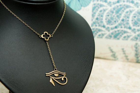 Eye of Horus and Four Leaf Clover dangle Necklace.  by MolaxChopa