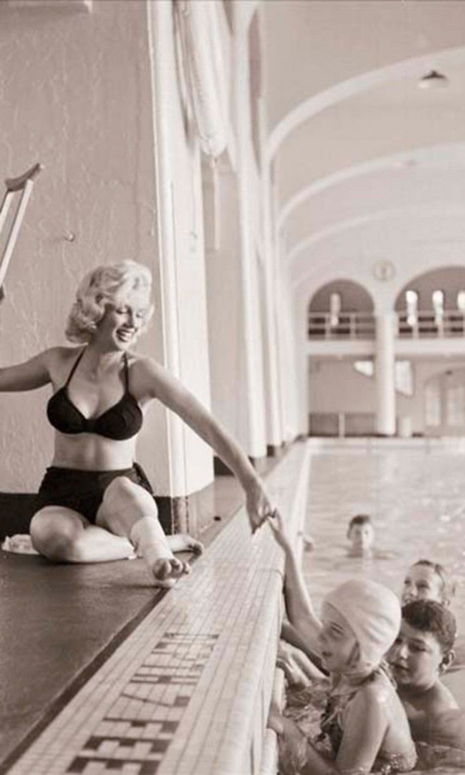 Marilyn Monroe poolside at the Banff Springs Hotel in 1953. She twister her ankle while filming River of No Return.
