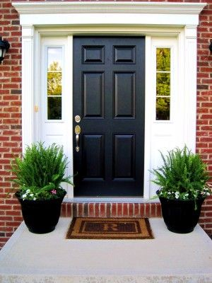 Kimberly Fern and Petunias will make nice pots at a front door. See site for painting the pots and putting bricks in for weight. Petunias should spill over the edges in time