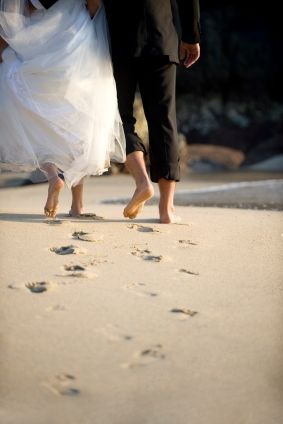 Weddings on a beach- wear those flip flops that leave just married imprints in the sand