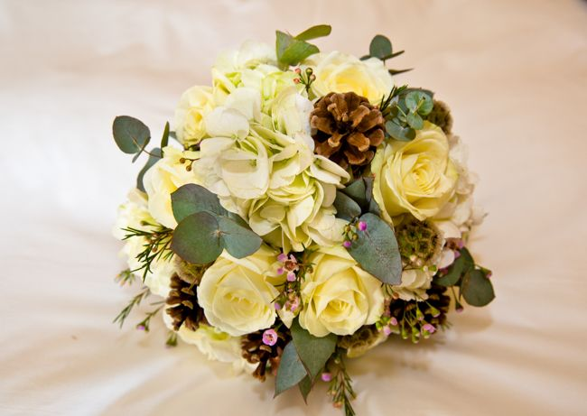 The bride's wedding bouquet at Cannizaro Park Hotel, Wimbledon South London. With great wedding photography including decorations, fabulous wedding dress & dresses flowers with centrepieces, hairstyle, rings and wedding cake.