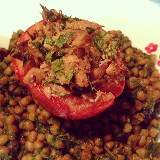 #vegan #vegetarian friendly tomatoes stuffed with tuna on top of curried lentils with spinach  Based on these recipes: 1) http://pinchofyum.com/roasted-corn-and-basil-stuffed-tomatoes  2) http://naturallyella.com/2012/11/23/red-lentils-and-spinach-in-masala-sauce/